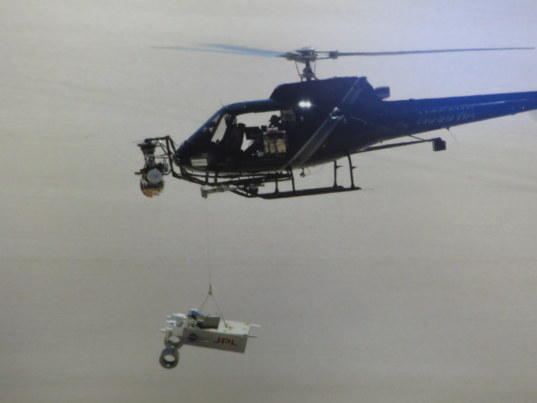 TDS suspended under helicopter for testing over the California desert