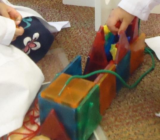Preschoolers building rockets
