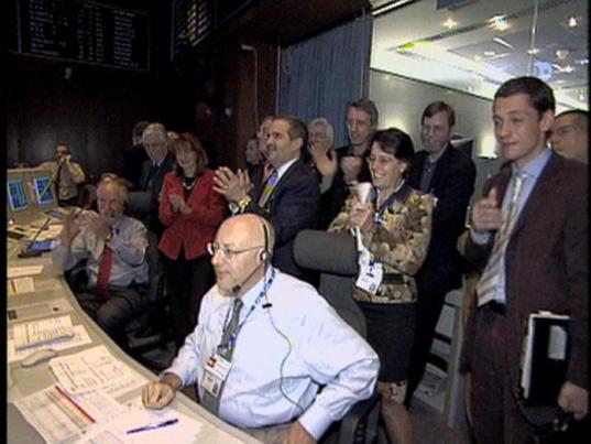 Huygens mission personnel celebrate the arrival of the first data