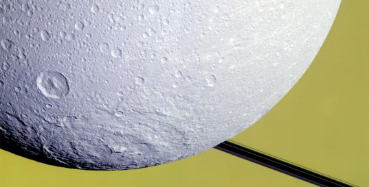 Dione's Evander basin caught against Saturn and rings