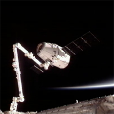 Dragon grappled by ISS