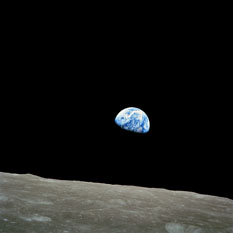 Earthrise over the lunar horizon from Apollo 8