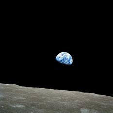 Earthrise over the lunar horizon from Apollo 8