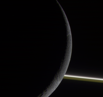 Crescent Enceladus with rings