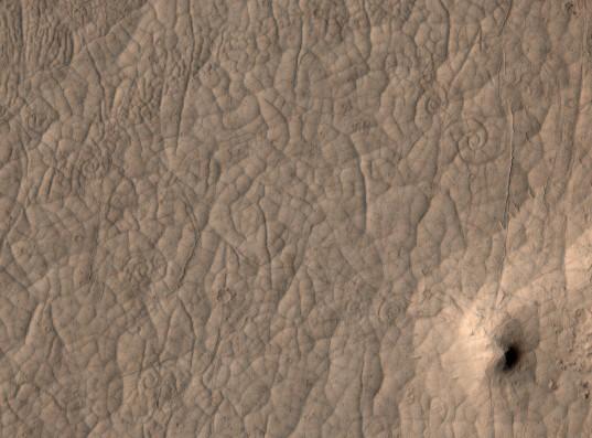 Lava swirls in a channel in Cerberus Palus, Mars