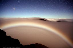 Mars rising over moonbow in Haleakala Crater in Maui
