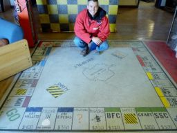 Macopoly: the gear stores' custom floor-painted Monopoly board.