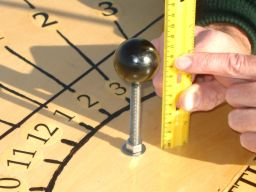 The center of the gnomon should be 8 centimeters above the board