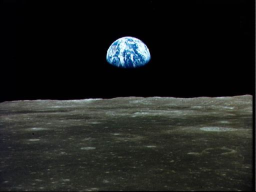 View of Earth rising over Moon's horizon taken from Apollo 11 spacecraft