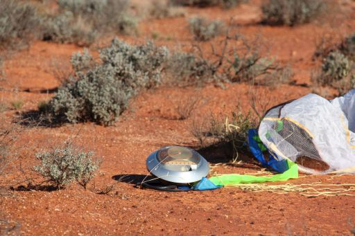 Hayabusa's sample return capsule sitting on the ground