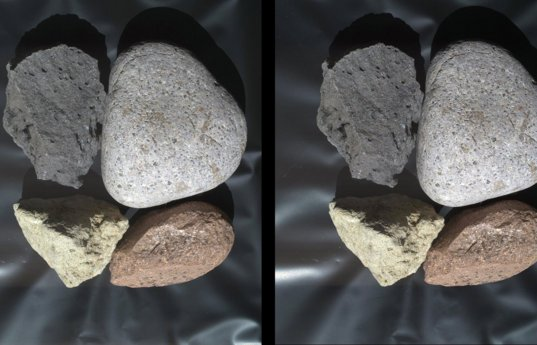 Crossed-eye stereo view of some rounded rocks from MAHLI