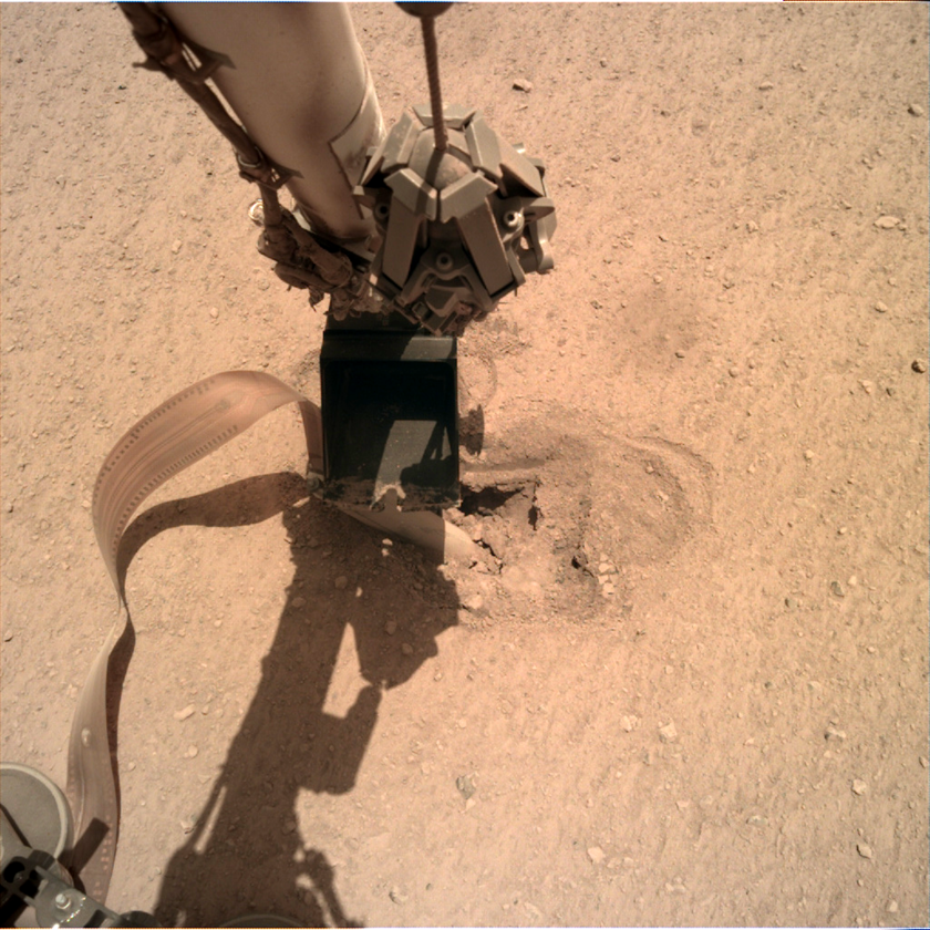 InSight presses its robotic arm on the mole