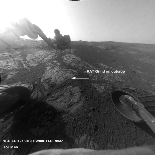 Front Hazcam view of the RAT poised above the outcrop at station 14
