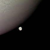Europa peeks from behind Jupiter