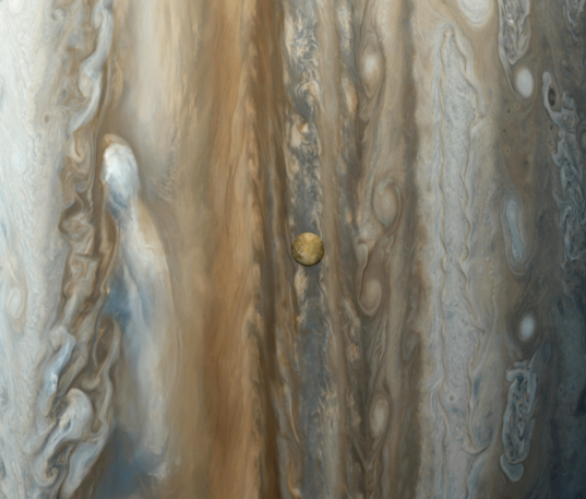 Io over Jupiter's clouds