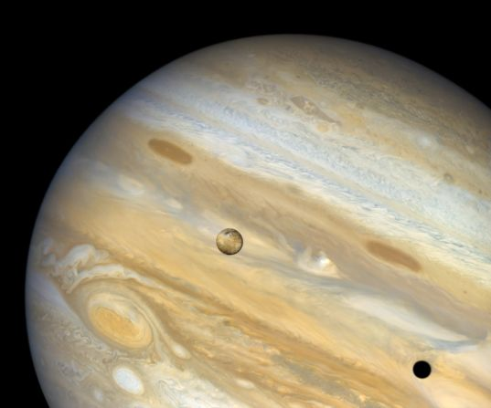 Io above Jupiter with shadow below