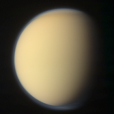 Global color view of Titan with a polar hood (7 December 2011)