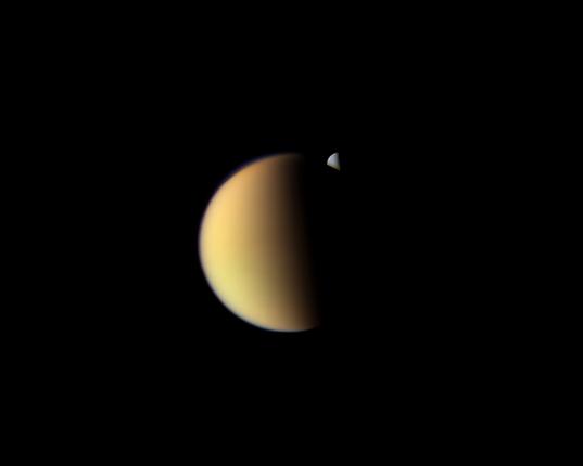 Rhea behind Titan