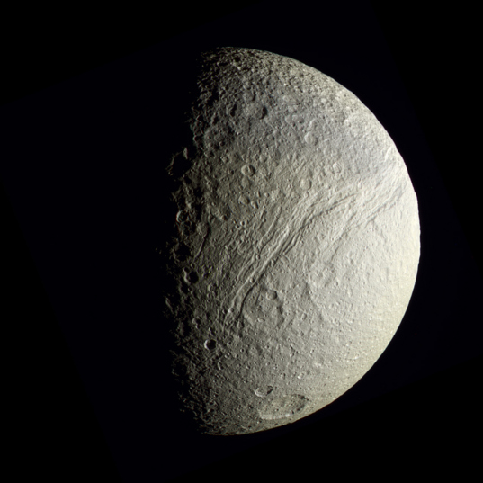 Tethys in enhanced color: south pole and southern Ithaca Chasma