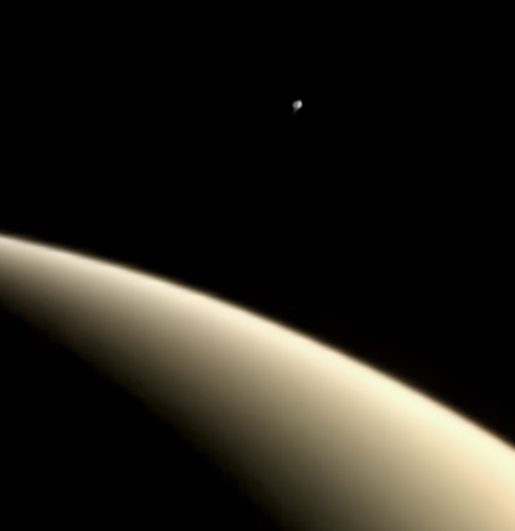 Erupting Enceladus over Saturn from Voyager 1