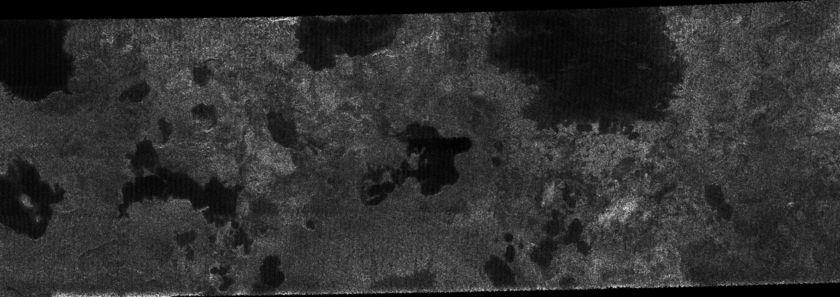 Probable lakes near Titan's north pole (80 degrees north)