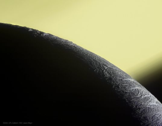 The limb of Enceladus in front of Saturn