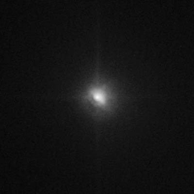 Tempel 1 as seen by Hubble, 19 minutes after impact (July 4, 2005 at 06:01 UTC)