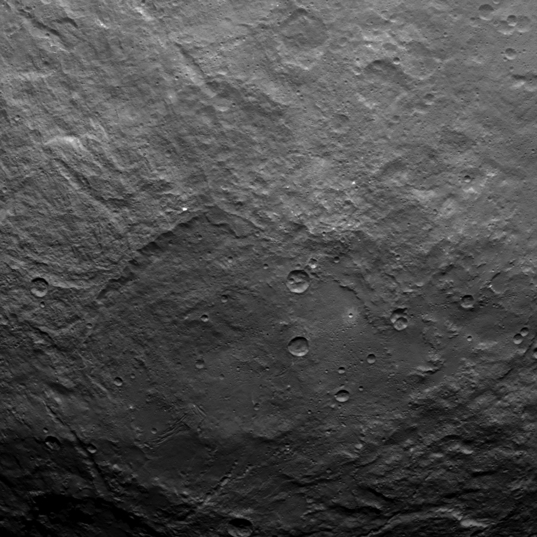 Ceres from Dawn's Survey Orbit: Crater Basin and Grooves