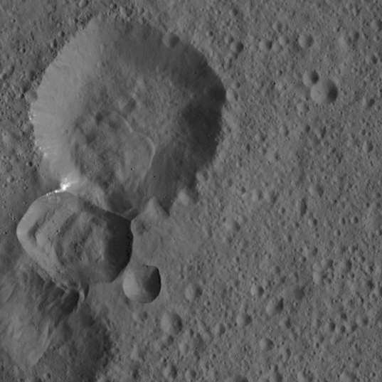 Bright Spotted Crater Rim on Ceres