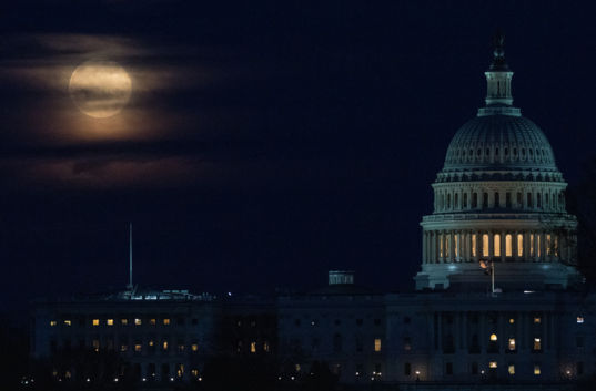 A Full Moon Rising Near the U.S. Capitol