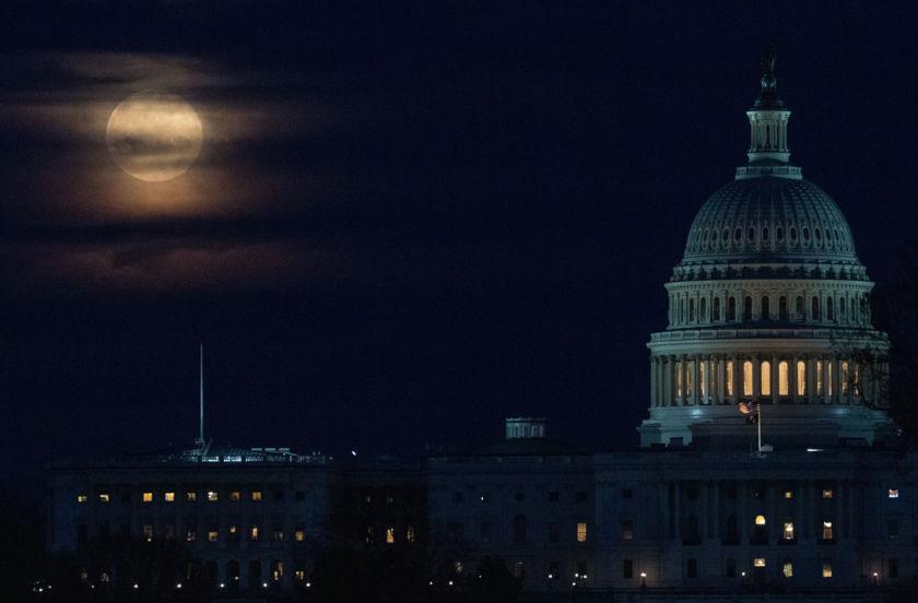 A Full Moon Rising Near the U.S. Capitol