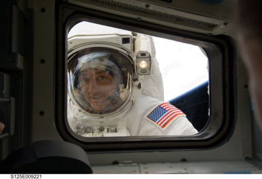 Mike Massimino on a spacewalk, May 17, 2009