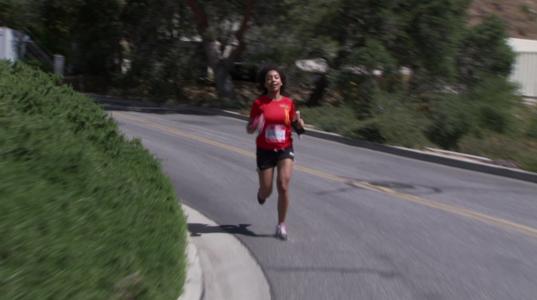 Moogega Cooper takes the last hill