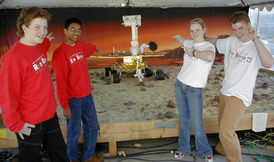 Student Astronauts: David, Saatvik, Janice, and Maciej with a model of the rover
