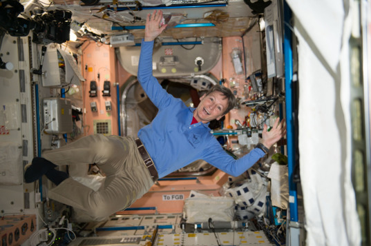 NASA astronaut Peggy Whitson stretches out