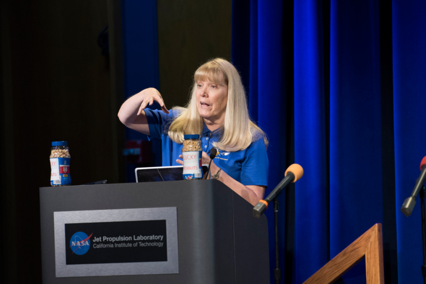 Cassini project scientist Linda Spilker holds an invisible Saturn in her hands
