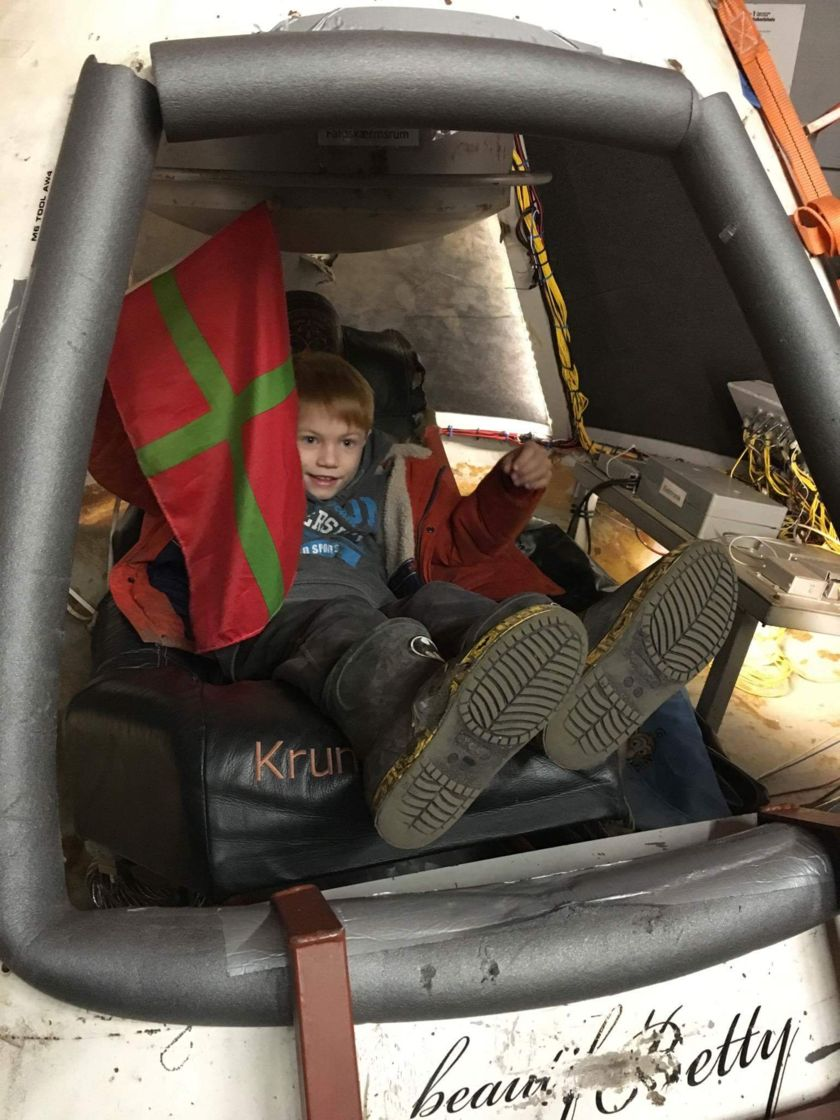 A young boy gets a ride in a space capsule at an event in The Netherlands