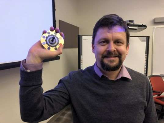 Kjartan Kinch with Mars 2020 calibration target prototype