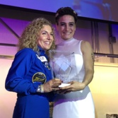 Yuri's Night founder Loretta Whitesides presents an award to Anousheh Ansari