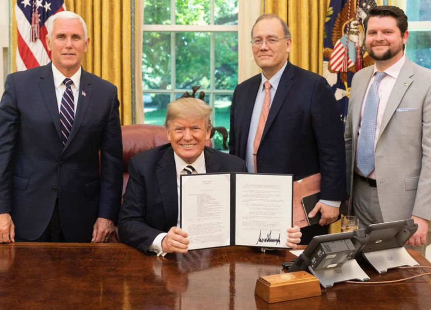 President Donald Trump holds the signed copy of Space Policy Directive 2