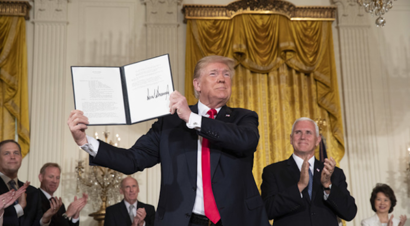 President Trump holds up the Space Policy Directive-3