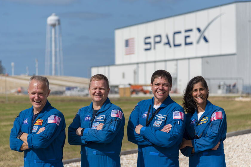 NASA's commercial crew astronauts with SpaceX hangar