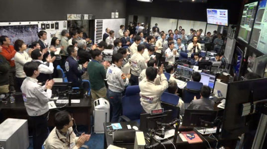 Celebration in Hayabusa2 mission control room after successful touchdown on Ryugu