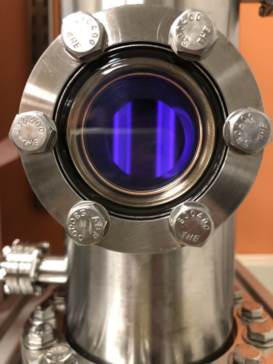 Peering inside Sarah Hörst's PHAZER chamber with its plasma glow.