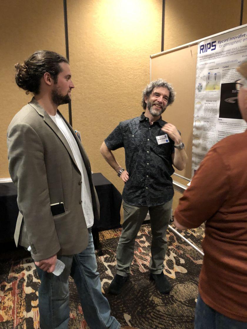 NIAC Symposium fellow Noam Izenberg with poster