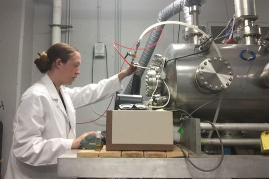 Doctoral student Caitlin Ahrens works in the Pluto lab at the University of Arkansas