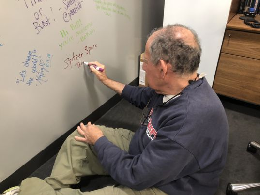 Mike Werner signing the Planetary Wall of Fame