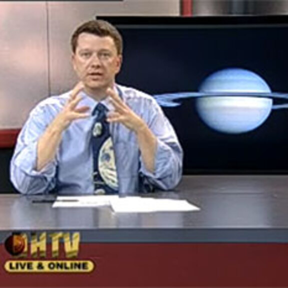 Bruce Betts screen shot teaching CSUDH Introductory Astronomy class with Saturn in background. head shot