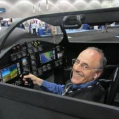 A happy Mat Kaplan in the XCOR Lynx cockpit's left seat at the Spacecraft Technology Expo, May 9, 2012. head shot