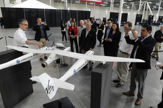 Elected officials join Virgin Galactic CEO George Whitesides for a description of LauncherOne